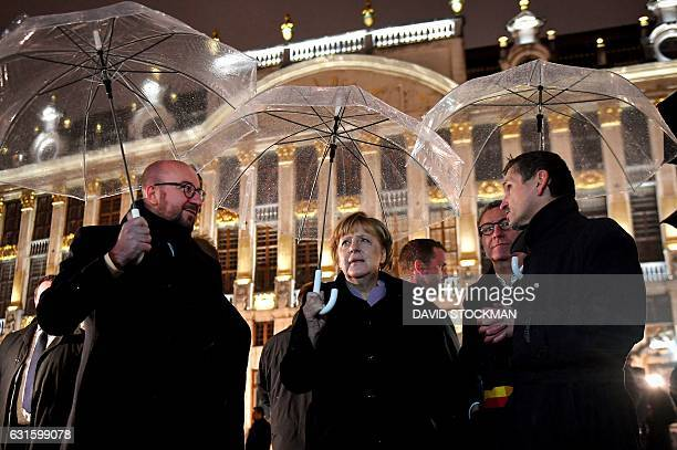 Belgian Prime Minister Charles Michel German Chancellor Angela Merkel and Brussels City mayor Yvan Mayeur visit the GrandPlace during a meeting in...