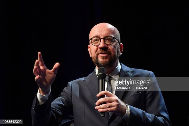 Belgian Prime Minister Charles Michel gives a speech next to French President during their visit at the University of Louvain on November 20 in...
