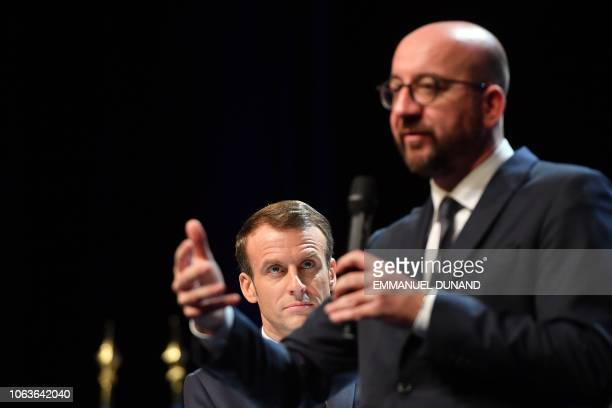 Belgian Prime Minister Charles Michel gives a speech next to French President Emmanuel Macron during their visit at the University of Louvain on...