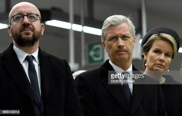 Belgian Prime Minister Charles Michel King Philippe Filip of Belgium and Queen Mathilde of Belgium attend a minute of silence at 0911 am in the...