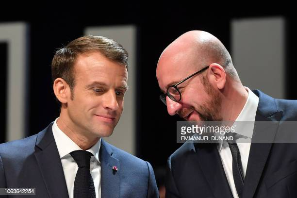 Belgian Prime Minister Charles Michel talks to French President Emmanuel Macron during their visit at the University of Louvain on November 20 in...