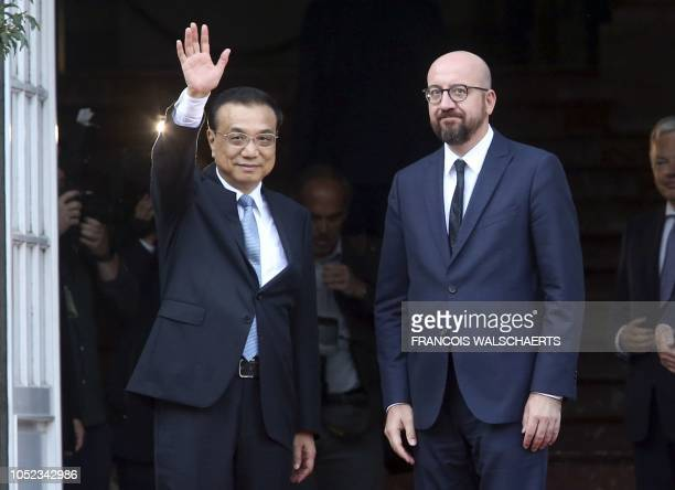 Belgian Prime Minister Charles Michel welcomes Chinese Premier Li Keqiang upon his arrival at the Palais d'Egmont during Keqiang's visit to Belgium...