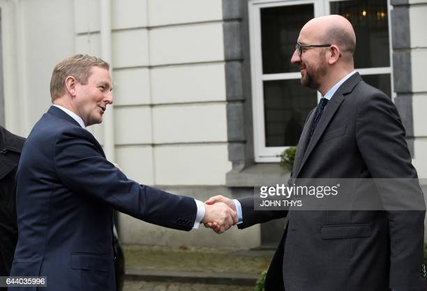 Belgian Prime minister Charles Michel welcomes Irish Prime minister Enda Kenny before their meeting in Brussels on February 23 2017 / AFP / JOHN THYS
