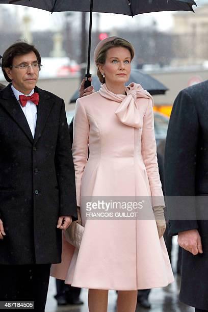 Belgian Prime Minister Elio Di Rupo and Queen Mathilde of Belgium visit a statue in Paris of King Albert I on horseback on February 6, 2014. AFP...