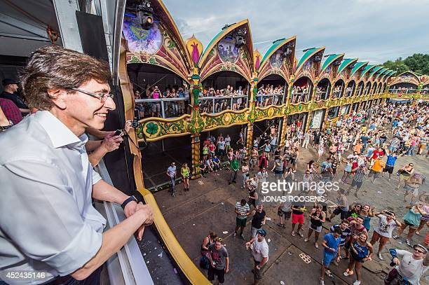 Belgian Prime Minister Elio Di Rupo visits during the third day of the Tomorrowland music festival, on July 20 in Boom. The 10th edition of...