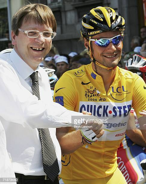 Belgian Prime Minister Guy Verhofstadt shakes hands with race leader Tom Boonen of Belgium and Quickstep prior to stage 4 of the 93rd Tour de France...