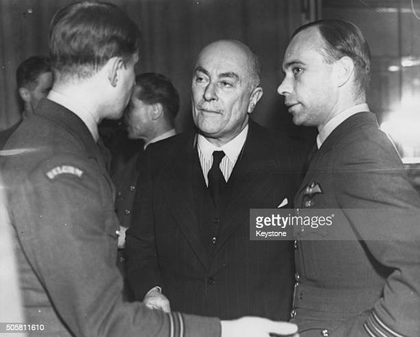 Belgian Prime Minister Hubert Pierlot meeting Squadron Leader Wells, of 609th Squadron, and another officer at a cocktail party, England, circa 1943.