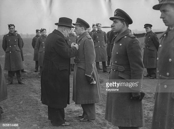 Belgian Prime Minister Hubert Pierlot presenting Croix de Guerre medals to Belgian airmen after the 100th enemy aircraft is shot down by Belgian...
