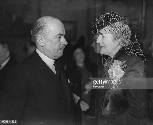 Belgian Prime Minister Hubert Pierlot talking to Clementine Churchill, wife of British Prime Minister Winston Churchill, at a reception celebrating...