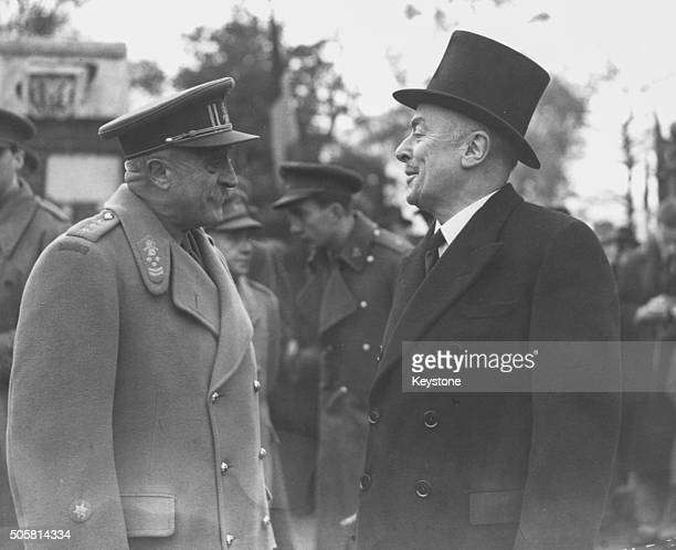 Belgian Prime Minister Hubert Pierlot talking to Victor Van Strydonck De Burkel, Head of Belgian Forces in London, at a Belgian Armistice Day...
