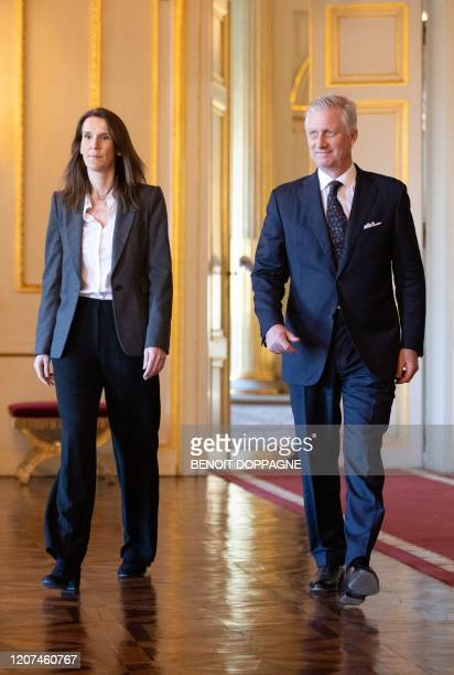 Belgian Prime Minister Sophie Wilmes and King Philippe Filip of Belgium walk ahead of an oath ceremony at The Royal Palace in Brussels on March 17...