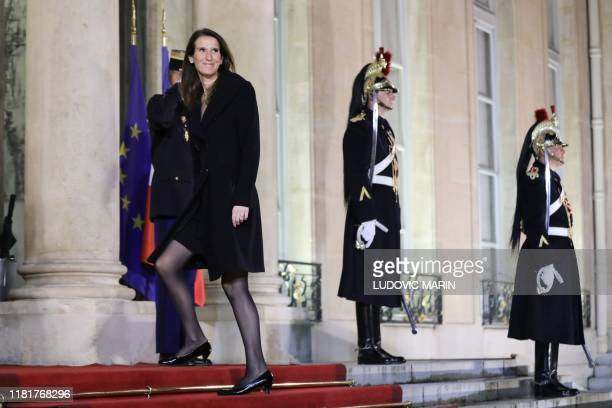 Belgian Prime Minister Sophie Wilmes arrives for a dinner with the participants of the Paris Peace Forum at the Elysee Palace in Paris on November 11...