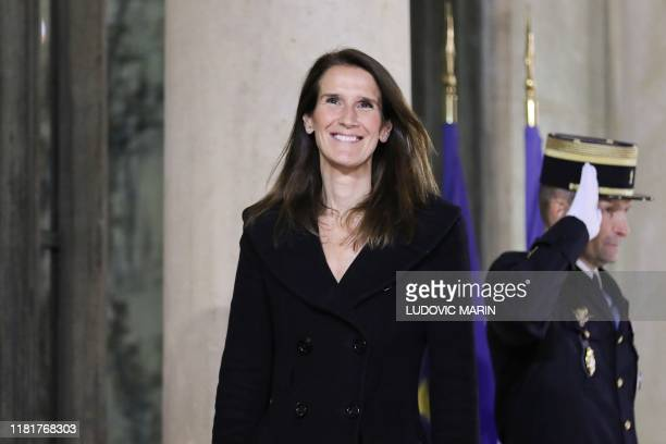Belgian Prime Minister Sophie Wilmes poses as she arrives for a dinner with the participants of the Paris Peace Forum at the Elysee Palace in Paris...