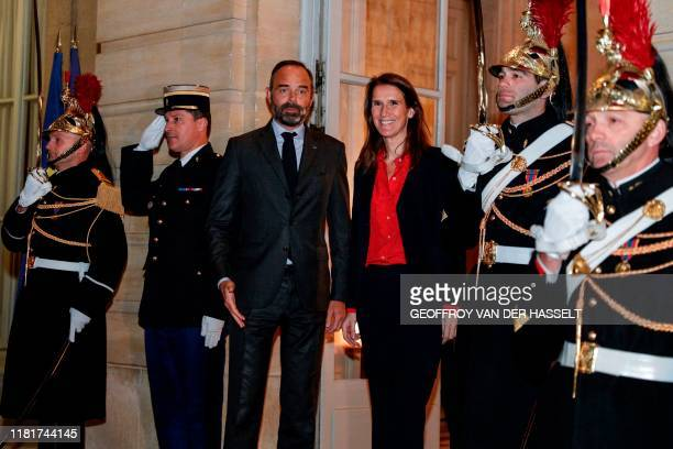 Belgian Prime Minister Sophie Wilmes poses with French Prime Minister Edouard Philippe as she arrives at the Hotel Matignon in Paris on November 11...