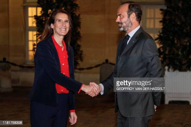 Belgian Prime Minister Sophie Wilmes shakes hands with French Prime Minister Edouard Philippe after a meeting at the Hotel Matignon in Paris on...