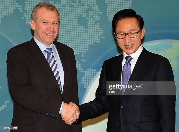 Belgian Prime Minister Yves Leterme shakes hands with South Korean President Lee Myung-Bak before their summit at presidential house on April 5, 2010...