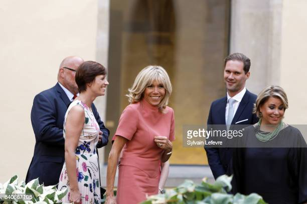 Belgian Prime Minister's partner Amelie Derbaudrenghien Brigitte MacronTrogneux France's first lady Luxembourg Prime Minister's husband Gauthier...