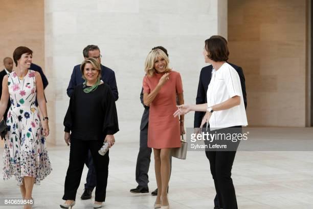 Belgian Prime Minister's partner Amelie Derbaudrenghien Grand Duchess Maria Teresa of Luxembourg Brigitte MacronTrogneux France's first lady visit...