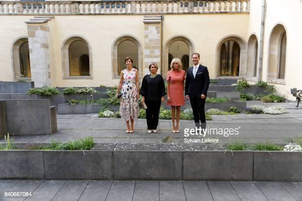 Belgian Prime Minister's partner Amelie Derbaudrenghien Grand Duchess Maria Teresa of Luxembourg Brigitte MacronTrogneux France's first lady...