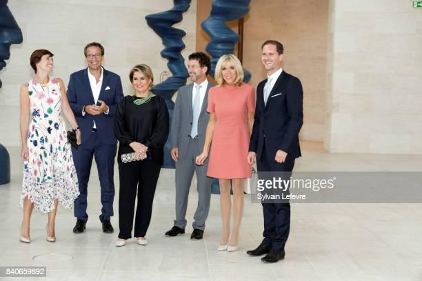 Belgian Prime Minister's partner Amelie Derbaudrenghien guest Grand Duchess Maria Teresa of Luxembourg guest Brigitte MacronTrogneux France's first...