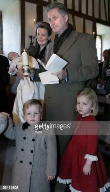 Belgian Prince Emmanuel is held by his mother Princess Mathilde while Crown Prince Philippe Prince Gabriel Princess Elisabeth look on during a...