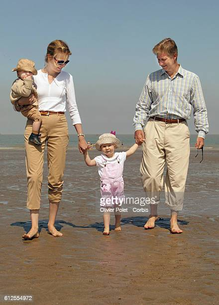 Belgian Prince Philippe and Princess Mathilde with their children Prince Gabriel and Princess Elizabeth along the sea front at Duinbergen | Location...