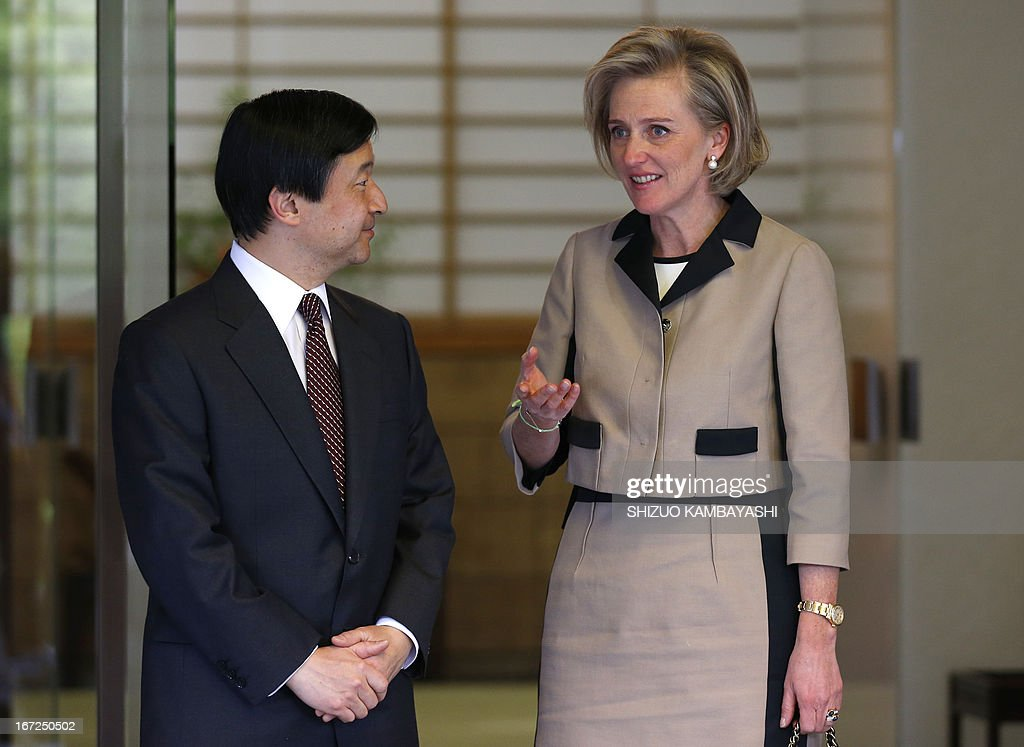 Belgian Princess Astrid (R) talks with Japanese Crown Prince Naruhito at Togu Palace in Tokyo on April 23, 2013.