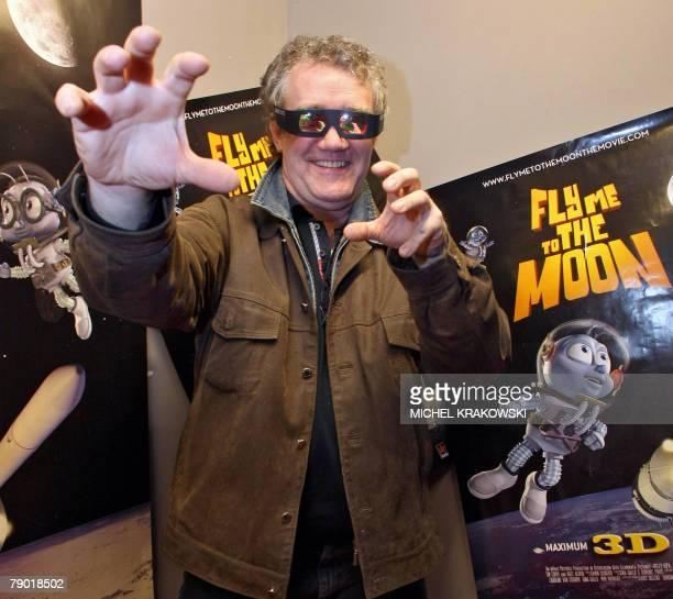 Belgian producer Ben Stassen gestures as he poses with 3D glasses prior to the premiere of the 3D film Fly Me to the Moon 16 January 2008 in Liege...