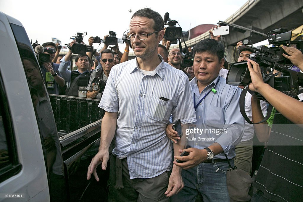 A Belgian protester is detained by Thai authorities after expressing his views for peace after streets were blocked by the military in order to stop the anti-coup protesters from arriving to the Victory Monument on May 29, 2014 in Bangkok, Thailand. The Thai military has warned Thai citizens about expressing dissent using social media. Thailand is known as a country with a very unstable political record and is now experiencing it's 12th coup with 7 attempted pervious coups.