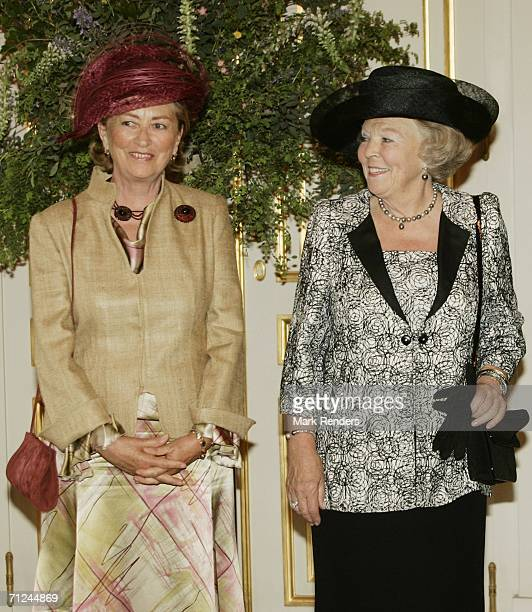 Belgian Queen Paola and Dutch Queen Beatrix pose for a photo at the Royal Palace during a 3day visit by Queen Beatrix on June 20 2006 in Belgium...