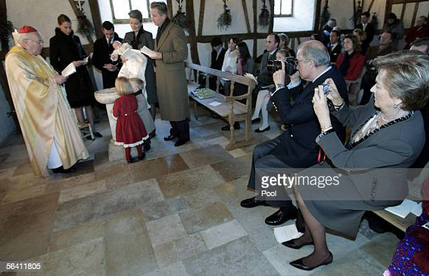 Belgian Queen Paola and King Albert II take pictures as Belgian Prince Emmanuel is baptized by Belgian Cardinal Godfried Danneels while godparents...