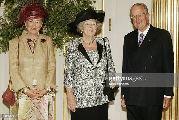 Belgian Queen Paola Dutch Queen Beatrix and King Albert pose for a photo at the Royal Palace during a 3day visit by Queen Beatrix on June 20 2006 in...