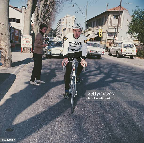 Belgian racing cyclist Eddy Merckx pictured wearing a Peugeot BP Michelin team jersey whilst riding a race bike in France in 1968