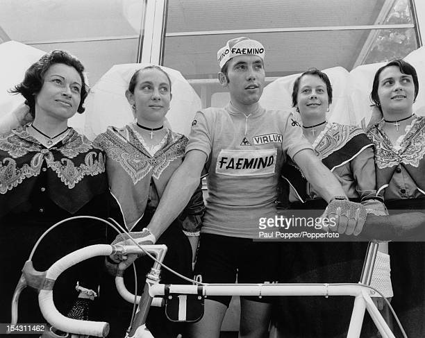 Belgian racing cyclist Eddy Merckx poses with local women in traditional costume at La Rochelle during the Tour de France 28th June 1970 Merckx went...