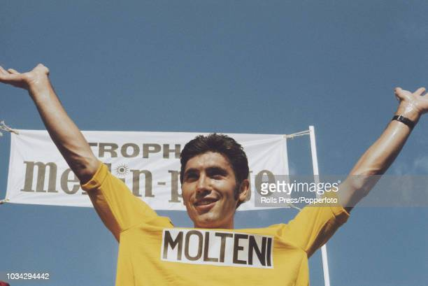 Belgian racing cyclist Eddy Merckx wearing the Molteni team jersey raises his arms in the air after the Molteni won the team time trial stage of the...