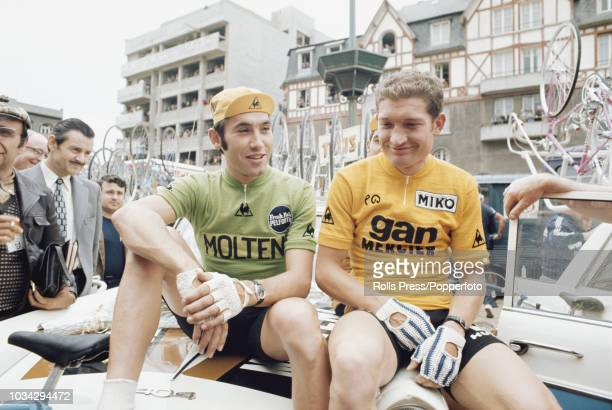 Belgian racing cyclist Eddy Merckx wearing the Molteni team jersey pictured on left with stage winner and new wearer of the yellow jersey French...