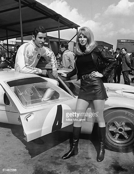 Belgian racing driver Jacky Ickx at Brands Hatch with his Ford GT40 and girlfriend Peta Selcombe during practice sessions for the BOAC International...