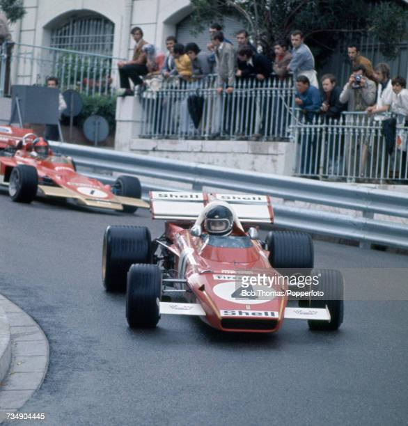 Belgian racing driver Jacky Ickx drives the Scuderia Ferrari Ferrari 312B2 Ferrari F12 followed by Brazilian racing driver Emerson Fittipaldi in the...