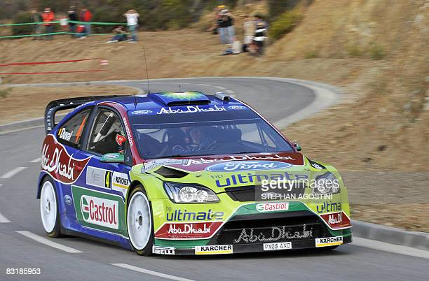 Belgian rally driver Francois Duval and his teammate French Patrick Pivato of the BP Ford WRT steer their Ford Focus RS WRC during a practice session...
