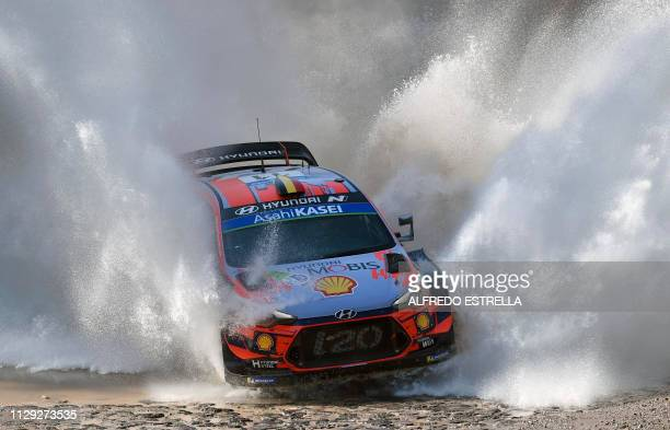 Belgian rally driver Thierry Neuville and codriver Nicolas Gilsoul of Hyundai Shell Mobis WRT compete during the first stage of the FIA World Rally...