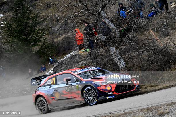 Belgian rally driver Thierry Neuville and his codriver Nicolas Gilsoul steer their Hyundai i20 WRC on January 24 during the SS4 SaintClement...