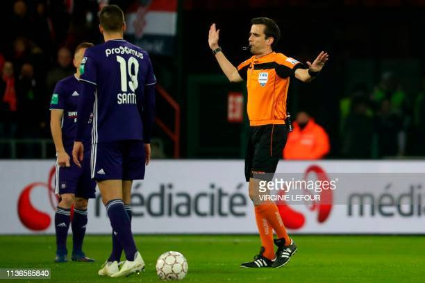 Belgian referee Erik Lambrechts stops the match after Anderlecht's supporters launched flares on the pitch during the Play-off 1 on day 4 of the...