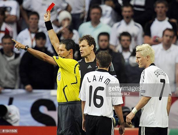 Belgian referee Frank de Bleeckere shows the red card to Germany's midfielder Bastian Schweinsteiger after he fouled Croatian midfielder Jerko Leko...
