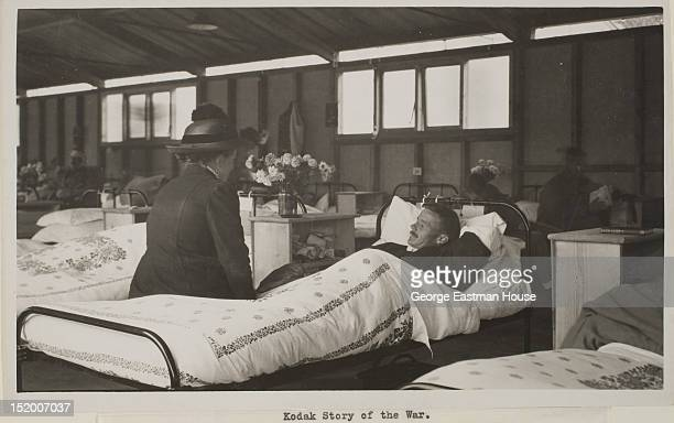 A Belgian refugee who has reached England finds her husband a Belgian soldier among the wounded in the British hospital Cambridge United Kingdom ca...