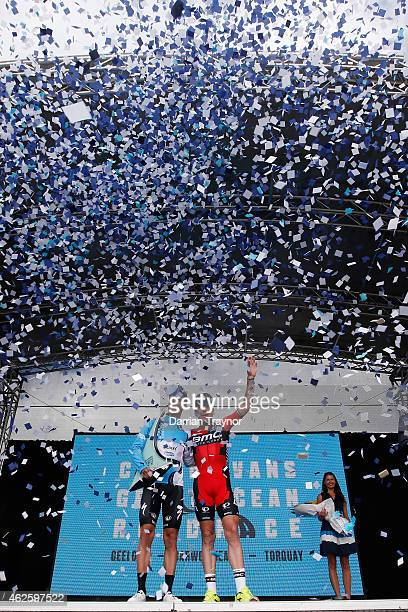 Belgian rider and ExtixxQuick Step team member Gianni Meersman celebrates on stage with Cadel Evans after the Cadel Evans Ocean Road Race on February...