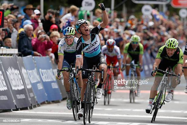 Belgian rider and ExtixxQuick Step team member Gianni Meersman celebrates winning the Cadel Evans Ocean Road Race on February 1 2015 in Melbourne...
