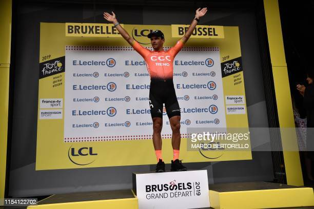 Belgian rider Greg Van Avermaet celebrates before putting on his best climber's polka dot jersey on the podium of the first stage of the 106th...