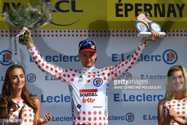 Belgian rider Tim Wellens celebrates his best climber's polka dot jersey on the podium of the third stage of the 106th edition of the Tour de France...