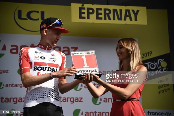 Belgian rider Tim Wellens receives his prize for day's most combative rider on the podium of the third stage of the 106th edition of the Tour de...