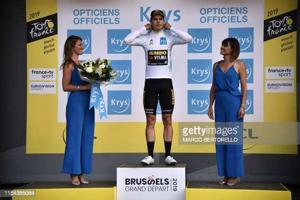 Belgian rider Wout van Aert celebrates his best young's white jersey on the podium of the second stage of the 106th edition of the Tour de France...